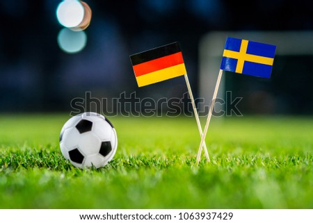 Germany - Sweden, Group F, Saturday, 23. June, Football, National Flags on green grass, white football ball on ground. #1063937429