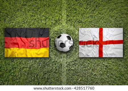 Germany vs. England flags on a green soccer field