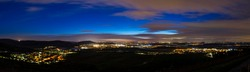 Germany, XXL landscape panorama of beautiful illuminated city lights of winnenden near stuttgart from above by night