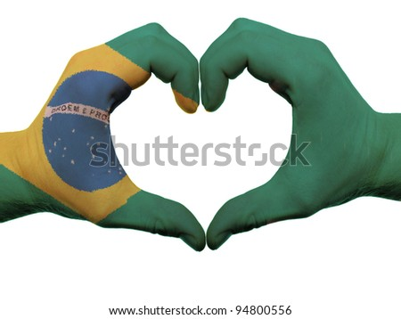 Gesture made by brazil flag colored hands showing symbol of heart and love, isolated on white background - stock photo