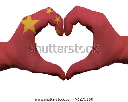 Gesture made by china flag colored hands showing symbol of heart and love, isolated on white background