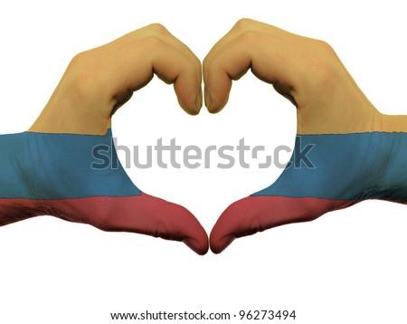 Gesture made by colombia flag colored hands showing symbol of heart and love, isolated on white background