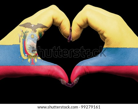 Gesture made by ecuador flag colored hands showing symbol of heart and love