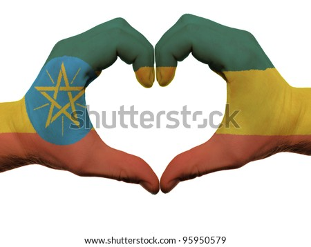 Gesture made by ethiopia flag colored hands showing symbol of heart and love, isolated on white background