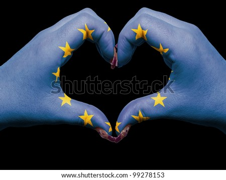 Gesture made by europe flag colored hands showing symbol of heart and love