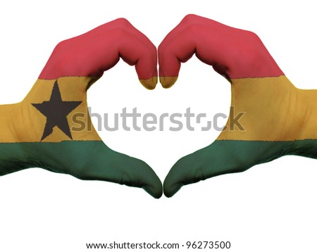 Gesture made by ghana flag colored hands showing symbol of heart and love, isolated on white background