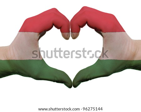 Gesture made by hungary flag colored hands showing symbol of heart and love, isolated on white background