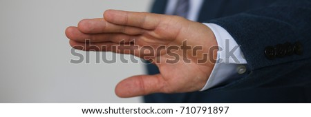 Gesture male hand rejection says no male businessman in a suit on a gray background I will not categorically claim #710791897