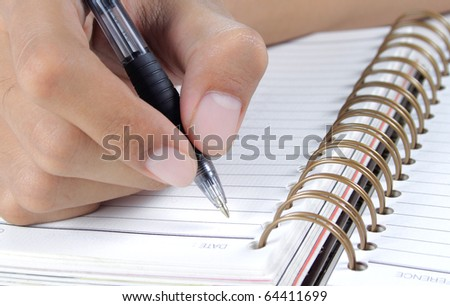 gesture man's hand writing on a binder