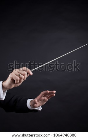 gestures with the conductor's hands #1064940380