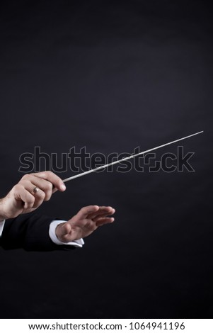 gestures with the conductor's hands #1064941196