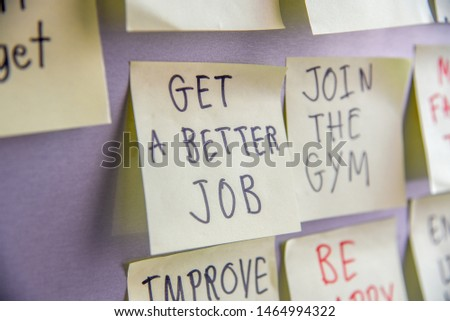 Get a better job handwriting with sticky notes on refrigerator background. New year goals or resolutions concept. #1464994322