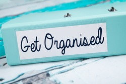 Get Organised, Organised folder on teal desk