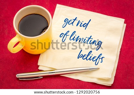 get rid of limiting beliefs concept - handwriting on a napkin with a cup of coffee