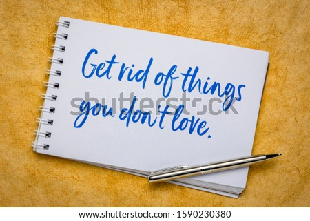 Get rid of things you do not love - minimalism tip  - handwriting in a spiral art sketchbook against yellow textured bark paper, declutter concept