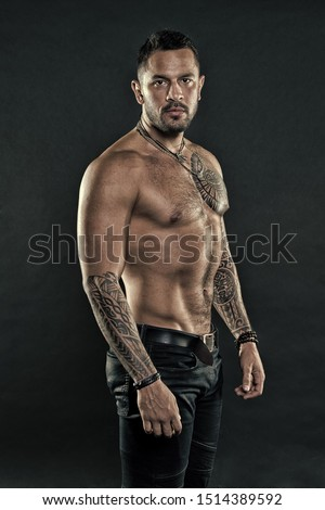 Get tattoo here. Man with muscular torso. Muscular man with sexy tattoo style. Macho style. Sexy is about confidence.