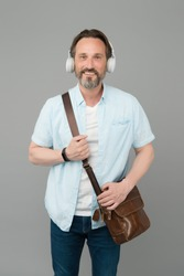 Get the very best audio experience. Bearded man listen to music grey background. Mature male wear audio headphones. Hi-Fi audio device. Listening to audio podcast. New technology. Modern life.