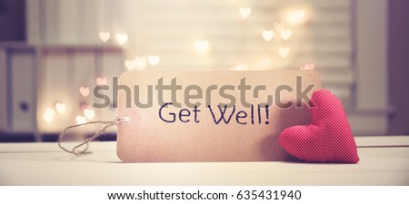 Get Well message with a red heart with heart shaped lights