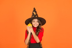 Get your Treats. happy halloween. trick or treat concept. carnival festive costume of witch. kid with small pumpkin. child celebrate autumn holiday. teenage girl in witch hat celebrate halloween.