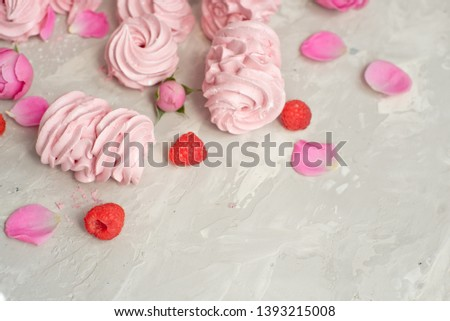 Getting a fresh pink blackcurrant marshmallow. Homemade sweet. Homemade marshmallow dessert. Pink zefir. Selective focus.