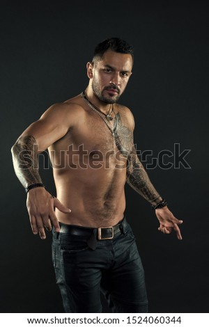 Getting a tattoo. Macho style. Man with muscular torso. Muscular man with sexy tattoo style. My body is sexy.