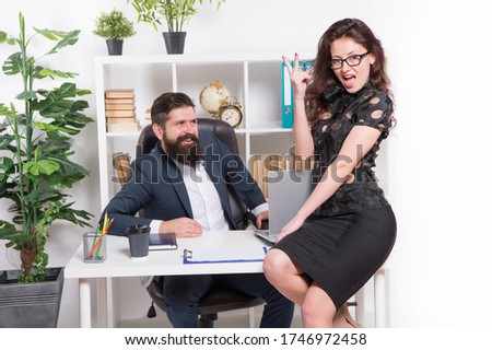 Getting better all the time. Happy woman show victory sign in office. Business couple celebrate great deal. Victory and success. Victory concept. Celebrating victory.