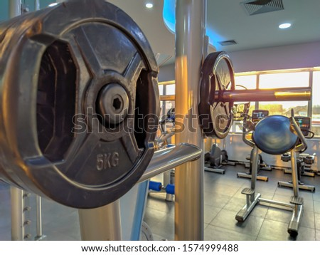 Getting fit in the gym while training and increasing strength and endurance. Exercising and bodybuilding for increasing muscle mass