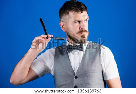 Getting perfect shape. perfect beard. Male fashion. businessman grooming in morning. unshaven barber in tie. Bearded hipster hold shaving blade. barbershop master with scissors. Man hold razor blade.