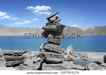 Getting the perfect balance. Building Cairns or stacking stones one above the other is considered a way of offering prayer in Buddhism. It can also be a gesture of wishing or asking for good fortune.
