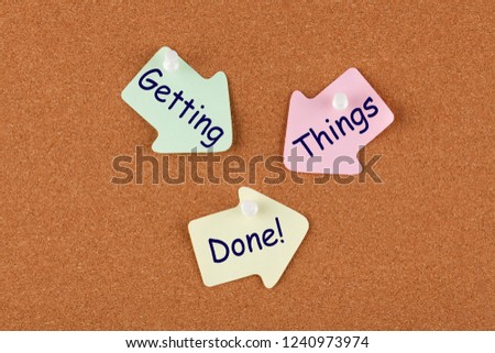 Getting Things Done written on color reminder notes with pin on cork board. Stress-Free. Business concept. #1240973974