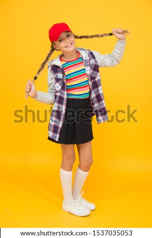 Getting your hairstyle to last all day. Happy child with braided hairstyle yellow background. Small cute girl smile with long hairstyle. Fashion look of pigtailed hairstyle.