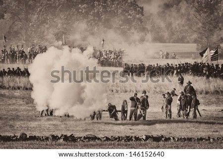 GETTYSBURG, PENNSYLVANIA - JULY 5: Reenactment of the Battle of the Wheatfield at the 150th anniversary of the Gettysburg Civil War battles on July 5, 2013 in Gettysburg, Pennsylvania - stock photo