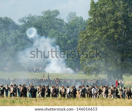 GETTYSBURG, PENNSYLVANIA - JULY 6, 2013: Reenactment of the Gettysburg battle at East Cemetery Hill to commemorate the 150th anniversary of the battles on July 6, 2013 in Gettysburg, Pennsylvania - stock photo