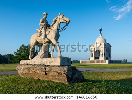GETTYSBURG, PENNSYLVANIA - JULY 5, 2013: 8th Cavalry monument and Pennsylvania Memorial at the Gettysburg National Military Park on July 5, 2013 in Gettysburg, Pennsylvania - stock photo