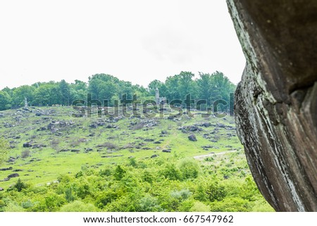 Gettysburg, USA - May 24, 2017: Little Round Top New York Monument in Gettysburg battlefield national park during summer with people #667547962