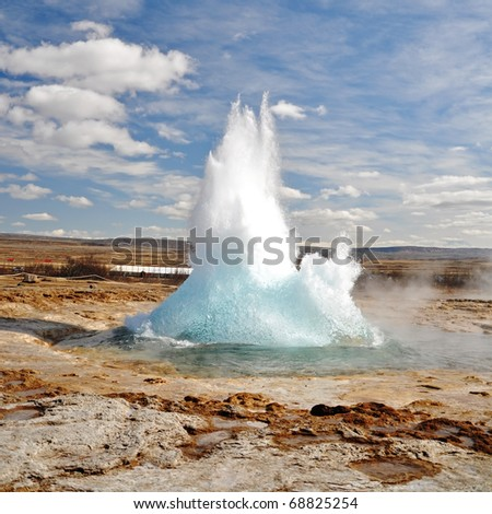Geyser eruption in a sunny day, Iceland