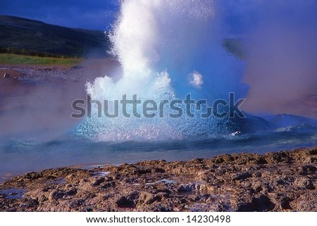 Geyser eruption in Geysir site, Iceland