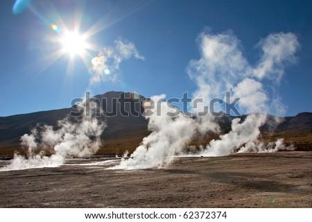 Geyser field El Tatio in back lighting, Atacama region, Chile