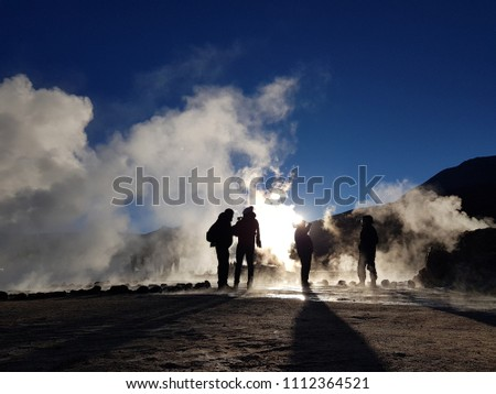 Geysers del Tatio, Chile - Tourists watching a geyser in the Geysers del Tatio field in the Atacama Desert, Northern Chile