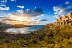Ghajn Tuffeha, Malta - Beautiful sunset at Ghajn Tuffieha beach on a lovely summer day with beautiful sky and clouds