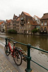 Ghent,Belgium: medieval architecture, on the riverfront and bicycle