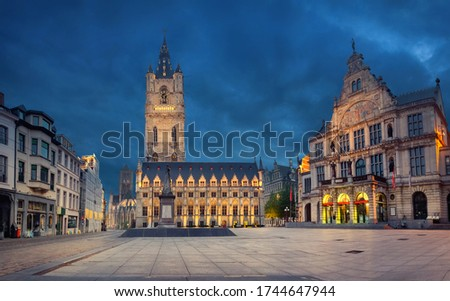 Ghent, Belgium. Sint-Baafsplein square at dusk with building of historic Town Hall and famous Belfry of Ghent Сток-фото ©
