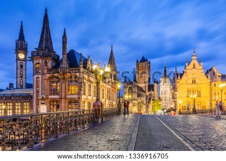 Ghent, Belgium. The Saint-Michielsbrug bridge, St Nicholas Church and Belfort van Gent at twilight.