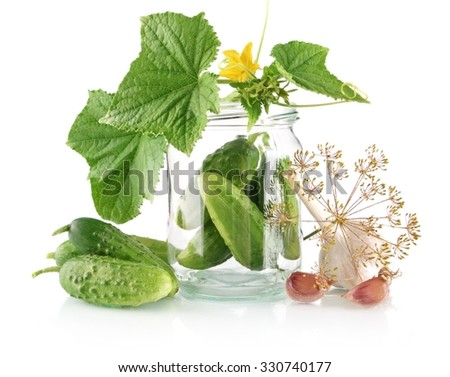Gherkins in jar prepare for pickling with flower bud,leaves,jar,garlic,dill flowers and tendrils isolated on white background