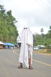 Ghost Cosplay for Haloween with white fabric/suit and eyeglass