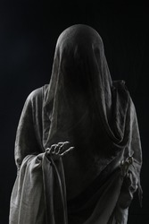 Ghost in dirty cloth with white bone as death halloween and after death belief. Horror movie , spooky novel. Dead man in bed sheet