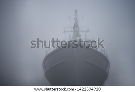 Ghost ship. Warship in the fog or mist as a flying Dutchman. Gray color. Mystery concept. Pirate Code, doomed vessel rise from the sea, spreading terror across the ocean lore. phantom ship doomed