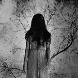 Ghost woman with dead tree in background