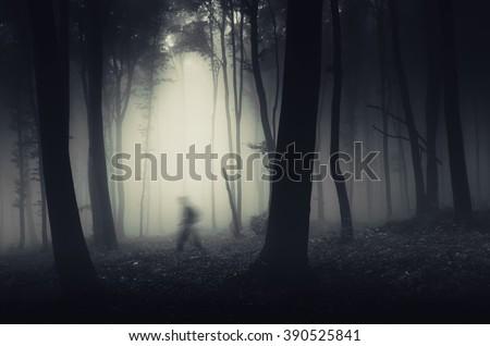ghostly figure in dark spooky forest halloween scene