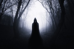 ghostly silhouette in spooky dark forest